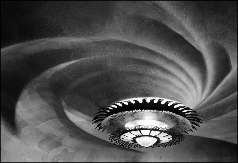 Detail of swirls in the ceiling, and lamp