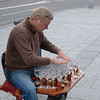Musical glasses player on the Madrid street corner.<br /> May 15, 2008