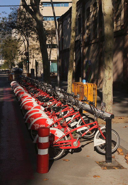 Parked bikes for hire in 22@ Innovation district Barcelona Spain