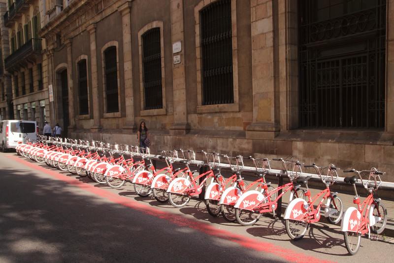 Parked bikes for hire La Rambla Barcelona Spain