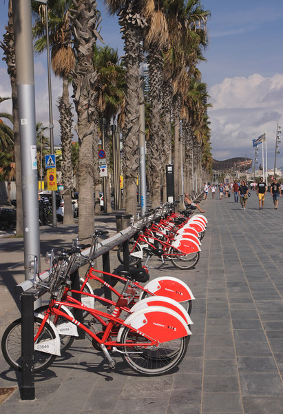 Parked bikes for hire Passeig Maritim Barcelona Spain