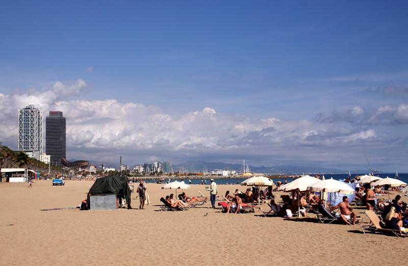 Sunbathing on Barcelona beach Spain