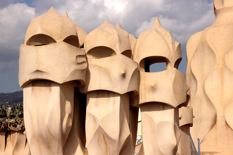 Sculpted chimneys on rooftop of La Pedrera Barcelona Spain