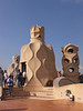 Sculpted chimneys on rooftop of La Pedrera Barcelona Spain