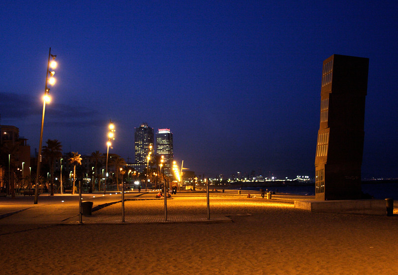 Barcelona Beach at night with large modern sculpture in foreground