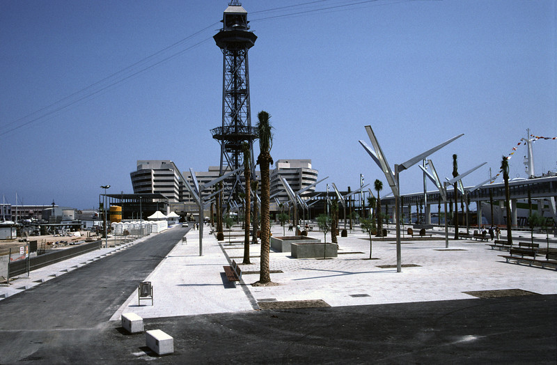 Cable Car tower at Port Vell with World Trade Centre in background Barcelona