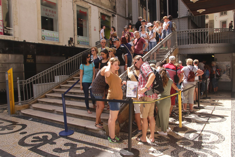 Tourists queueing at base of Elevador de Santa Justa Lisbon Portugal