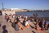 People relaxing at Cais Das Colunas near Praca do Comercio Lisbon Portugal