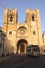 Tram passing Se Cathedral Alfama Lisbon Portugal