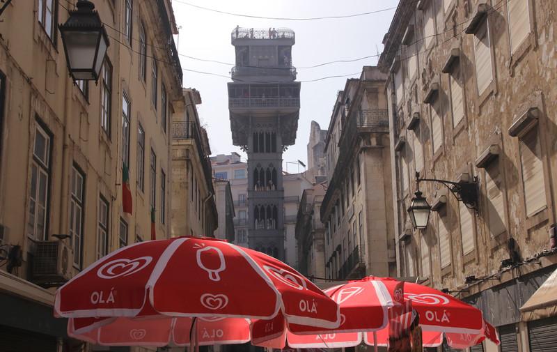 Red Parasols and Elevador de Santa Justa Lisbon Portugal