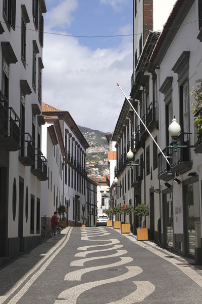 Cobbled lane in Funchal with decorative paving