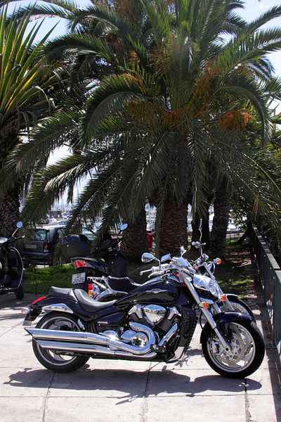 Motorbike parked at seafront Funchal Madeira