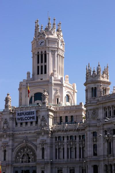 Palacio de Comunicaciones City Council displaying Refugees Welcome banner Madrid Spain