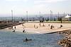 People swimming at the Explanada de Gamazo Santander Spain