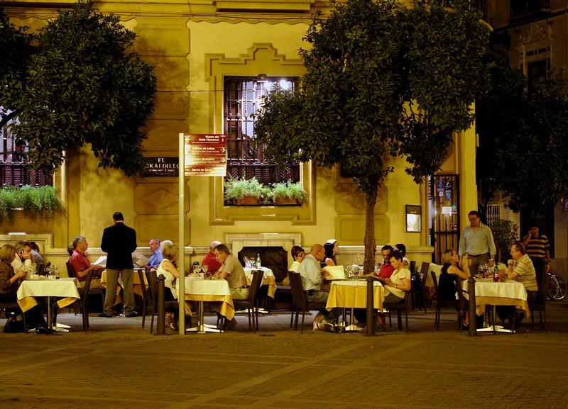 Restaurant in the Plaza Virgen de los Reyes Seville at night October 2007