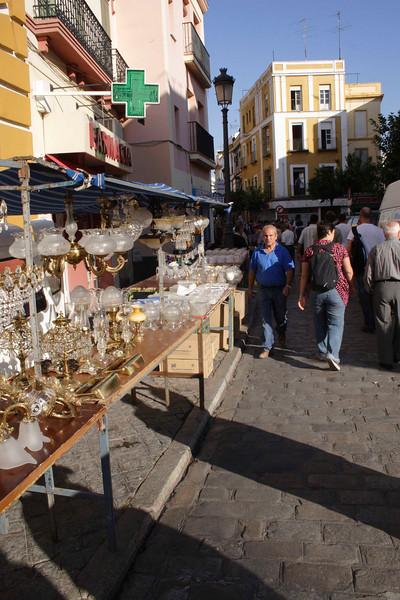 Ornamental lamp stall at Calle de la Feria Street Market Seville October 2007