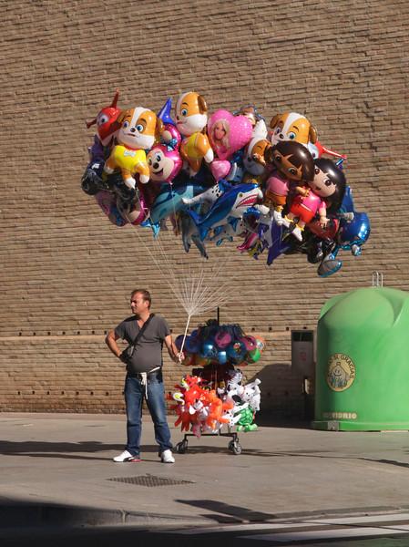 Balloon seller  in Plaza del Pilar Zaragoza Spain