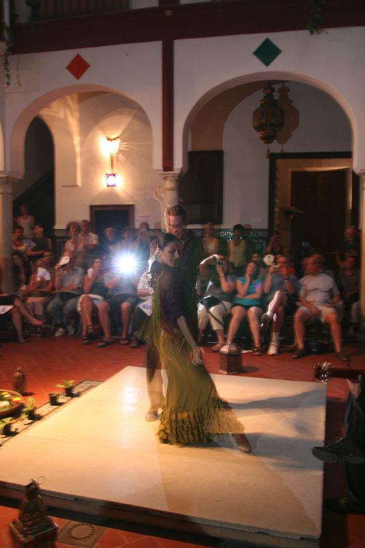 Traditional flamenco dancers entertained after guitar and singing