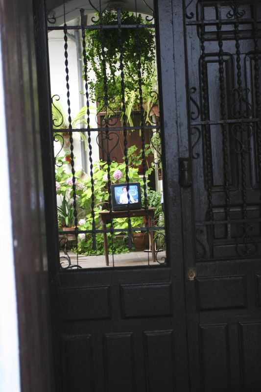 The courtyards are cool and inviting. People spend a lot of time here, as evidenced by the TV set