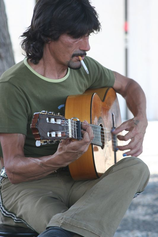 A gypsy man plays for his supper
