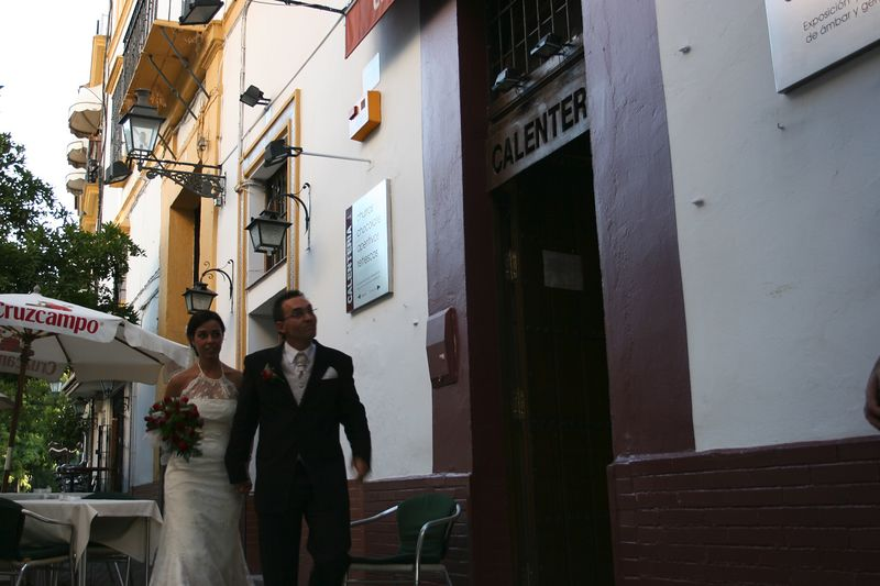 Later, as we have a snack, the couple from the cathedral walks switfly by