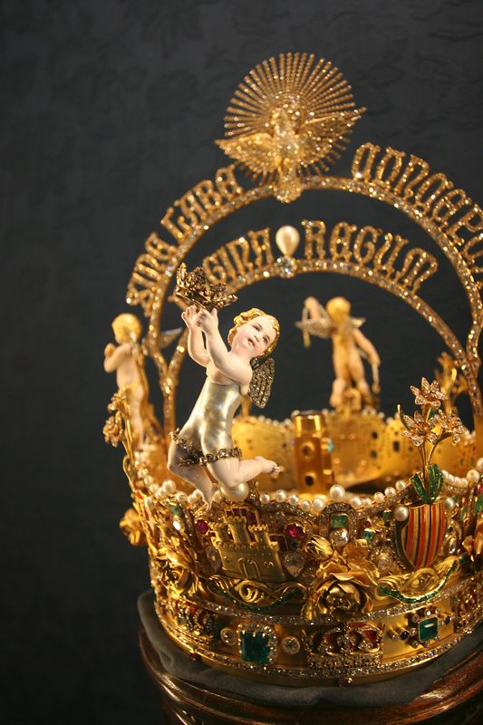 A royal crown in the cathedral treasury. the body of the angel is a single pearl