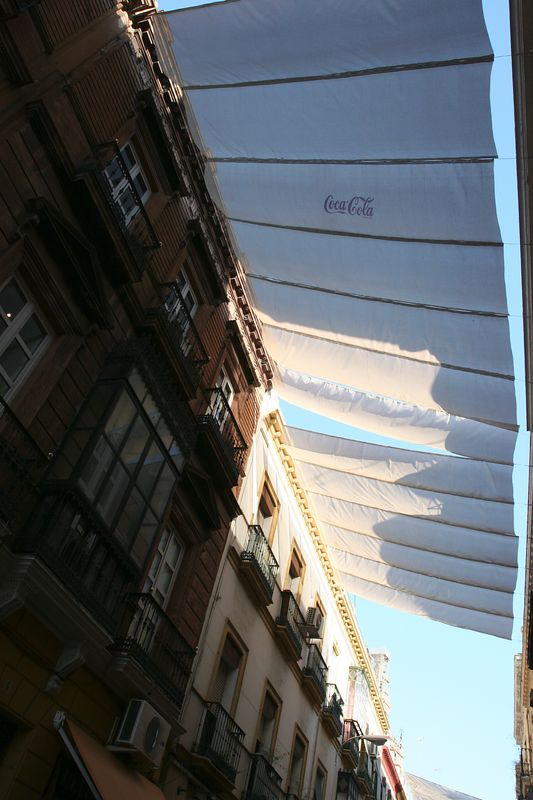 The main shopping street of Seville is covered to shade the shoppers during the heat of the day