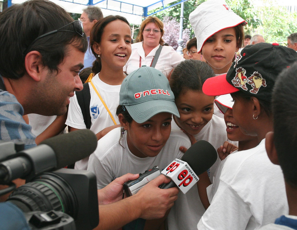 Madrid - a reporter interviews a girl at a rally to support a free Sahara