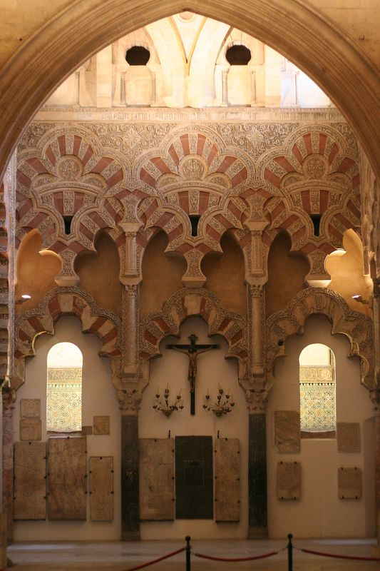 Imagine a huge square mosque, supported by thousands of pillars. To put the church in the middle, some of the walls used the moorish pillars for support