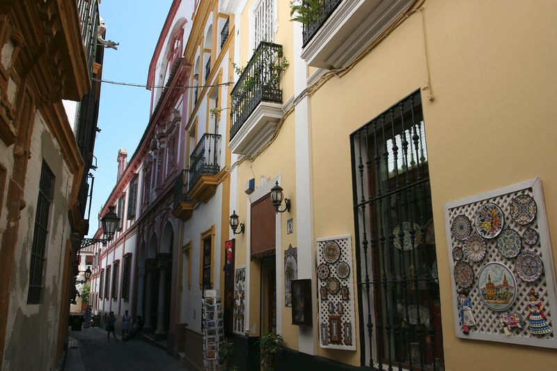 Typical street in Seville's Jewish quarter. The streets are mainly deserted during the heat of the afternoon, except for this photographer...