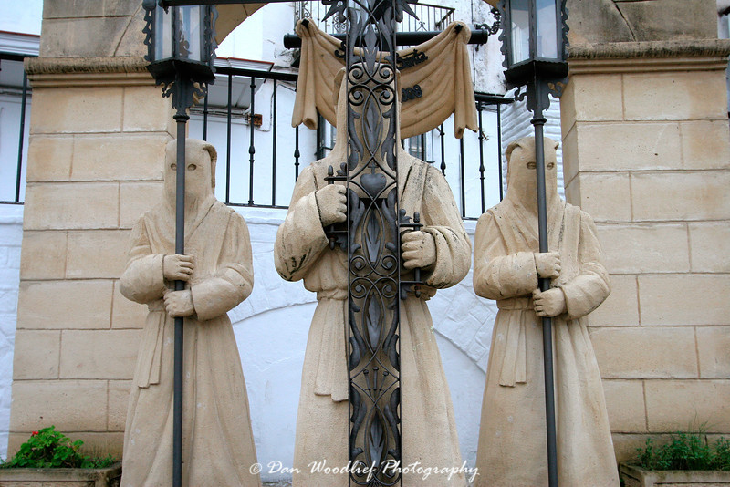 A sculpture group in Arcos, portraying the type of outfits worn during Semana Santa processions.