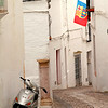 White-washed buildings, scooter, and football (soccer) flag. Now this is Andalucía.
