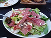 Delicious salad with Iberian ham and pine nuts toasted with honey.