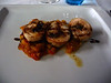 Shrimp on a skewer with a tomato salsa