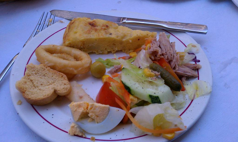 Lunch with tortilla espanola, calamari, and ensalada in Cartagena, our first day there.