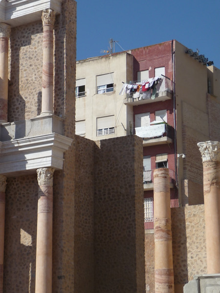 Some columns in the Roman theater (and some apartments and laundry in the background!).