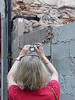 Susan photographing feral cats at a construction site. They seemed fairly healthy and people had left bowls of dry food as well as canned food for them.
