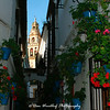 The bell tower of La Mezquita viewed from flower-bedecked Calle de las Flores.