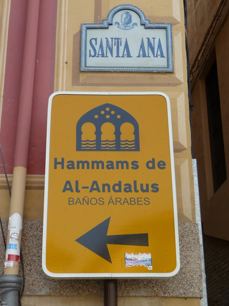 Street signs pointing to the Arab baths in Granada.