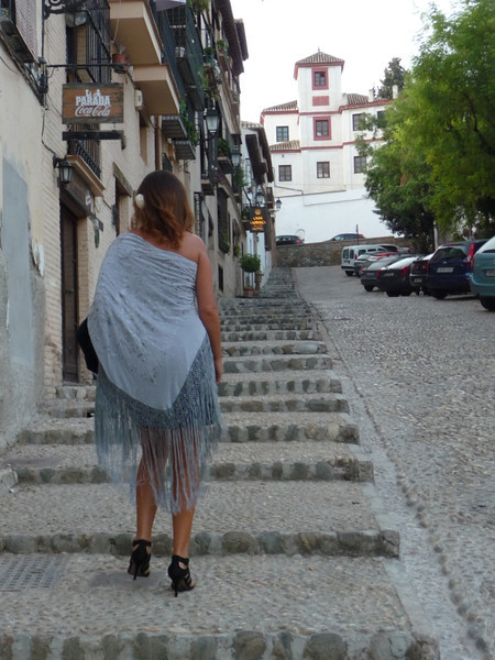 On our first night in Granada, which was a Saturday, we saw a lot of very fancily dressed people who had apparently just been to a wedding. This young woman was one of them. We marveled at how she could negotiate the cobbled sidewalks in those heels!