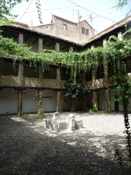 Interior courtyard of one of the oldest market areas in Granada. Susan's guidebook said there were crafts shops in here, but it was evidently out of date! Still, an interesting place to glimpse history in.