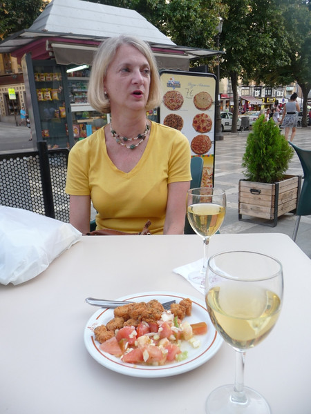 Sitting in Plaza Nueva in Granada with vino blanco and some tapas.