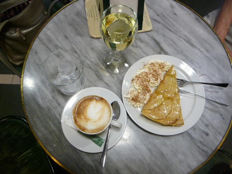 Snack time at the Cafe d'Italie with cappuccino, wine, and an apple tart.