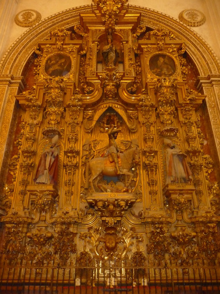 Elaborate screen with paintings behind the altar in the Cathedral