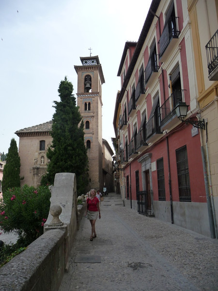 Susan near the wall walking along Douro Street in Granada.