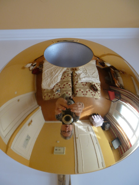 My reflection in a highly polished ceiling lamp over our beds in the hotel room in Granada.