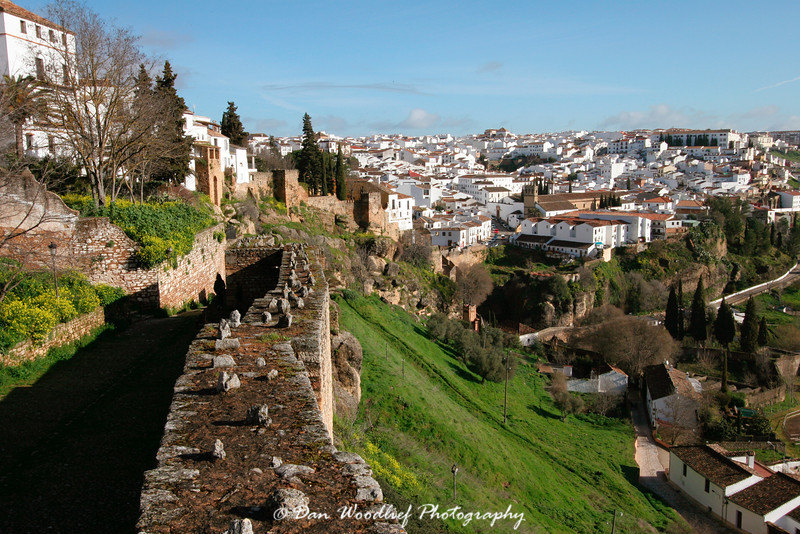Old defensive wall leading to a view of Ronda, Spain.