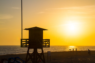 Sun Setting Behind Lifeguard Tower