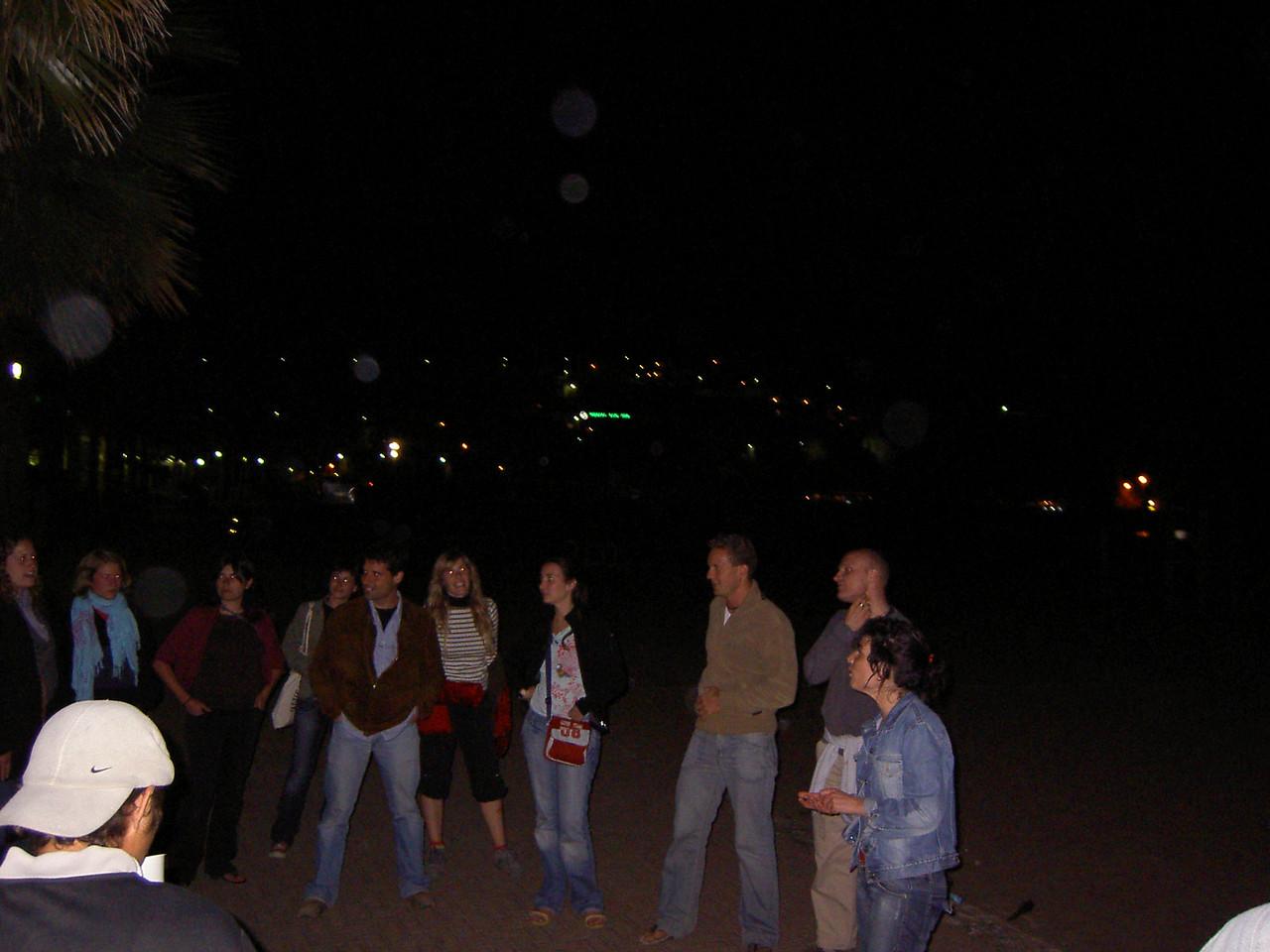 Drunken revellers on the beach
