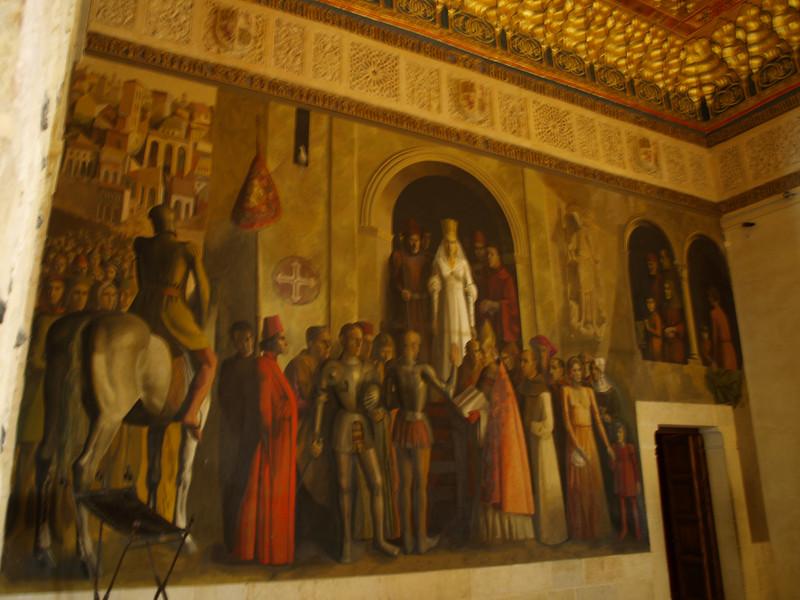 Uno de los muros de la Sala de la Galera en el Alcázar, representa la proclamación en Segovia de Isabel la Católica como reina de Castilla y León, el 13 de diciembre de 1474, obra de Carlos Muñoz de Pablos.